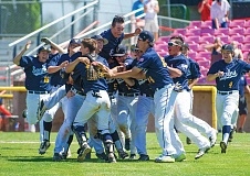 HILLSBORO TRIBUNE PHOTO: KENT FRASURE - Hood River Valley baseball players rush the field in celebration after the final out of last Saturday's Class 5A baseball championship at Volcanoes Stadium in Keizer. The Eagles beat Liberty 2-0 to win the state title.