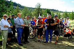 PHOTO COURTESY OF GREG CRASS - Cyclists and Lower 66 Trail volunteers gather for ribbon cutting on Thursday.
