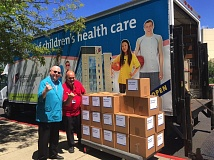 CONTRIBUTED PHOTO - Two employees of Legacy Health System stand with food collected for area food banks during the systems May No One Go Hungry drive.