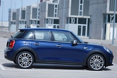 BMW NORTH AMERICA - Yes, those are four doors on the 2015 MINI Cooper. But the bigger news is the selection of engines in the line up.