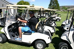 JASON CHANEY - Zach Lampert, head golf professional at Meadow Lakes, poses with the outgoing fleet. New, blue Yamaha brand carts should arrive in July.