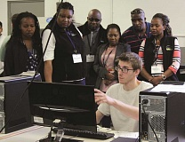 INDEPENDENT PHOTO: TYLER FRANCKE - Nicholas Boatwright, a youth offender, demonstrates a computer modeling program to six delegates from the African nation of Botswana during their visit to MacLaren Youth Correctional Facility in Woodburn last week.