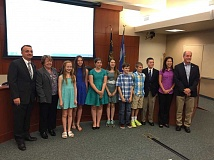 SUBMITTED PHOTO - Sixth-graders from Rosemont Ridge Middle School presented the results of their economic development summit to West Linn's City Council June 8. From left, Council President Thomas Frank, councilor Brenda Perry, Sophia Nielsen, Bianca Rusnak, Heather MacLaren, Julia Hutchinson,  Henry Bezner, Axex Nazario, Andrew Van Horn, City Councilor Jenni Tan and Mayor Russ Axelrod.