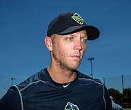 PAMPLIN MEDIA GROUP: CHASE ALLGOOD - Shelley Duncan, new manager of the Hillsboro Hops, meets with reporters Wednesday at Ron Tonkin Field on the eve of the team's Northwest League opener at Spokane on Thursday.