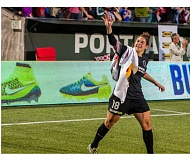 TRIBUNE PHOTO: CHRIS OERTELL - Michelle Betos waves to fans after the Portland Thorns goalie scored a goal in the final seconds Friday night, giving the home team a 1-1 draw with FC Kansas City.