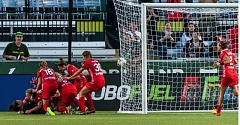 TRIBUNE PHOTO: CHRIS OERTELL - Portland Thorns teammates mob Michelle Betos after her tying goal and the final whistle against FC Kansas City.