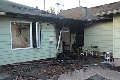 COURTESY PHOTO: HILLSBORO FIRE - Improperly discarded smoking materials caused an early morning house fire on Evergreen Road that displaced 11 residents.