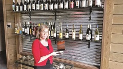 GEORGIA NEWTON - Oregon Wine Garden manager Christine Jeffries holds the award the restaurant recently received from the Clackamas County Tourism's Mt. Hood Territory.