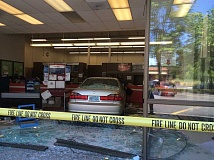 JIM WOLF - Tigard Police are investigating after a car crashed through the Tigard Post Office, injuring one person.
