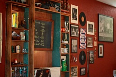 CONNECTION PHOTO: KELSEY O'HALLORAN - Luke Derosso's side of the shop is decorated with classic barbershop memorabilia and old family photos.