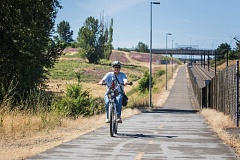 TRIBUNE PHOTO: JONATHAN HOUSE  - Linda Robinson, an East Portland parks advocate and cofounder of the Friends of Gateway Green, takes a ride to the site last week from the Gateway Transit Center. Pending another successful crowdfunding campaign this fall, the project could break ground next year.