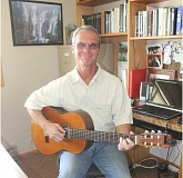 SUSAN MATHENY/MADRAS PIONEER - Pastor Ron Mulkey uses his musical talents in outreach ministries.