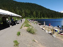CONTRIBUTED PHOTO - Children and adults alike enjoy the sunshine for a junior fishing clinic at Trillium Lake on Mount Hood.