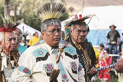 HOLLY M. GILL - From left, Jeff Sanders, Captain Moody and Charles Nathan participate in last year's grand entry on the first day of Pi-Ume-Sha. This year's event runs from June 26-28 on the powwow grounds next to the community center in Warm Springs.