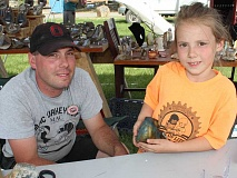 HOLLY M. GILL - Steve Keever, of Madras, and his daughter, Autumn, display a rock Keever named after his daughter - Autumn Hope jasper. Keever is among 90 vendors who were setting up at the Jefferson County Fairgrounds Wednesday, in preparation for the annual All Rockhounds Pow-Wow Club of America's annual event, June 25-28.