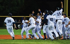 HILLSBORO TRIBUNE PHOTO: KENT FRASURE - Hillsboro Hops players celebrate after Fernery Ozuna (second from left) drew a bases-loaded walk to force home the winning run in a 5-4 victory against Salem-Keizer on Tuesday.