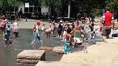 TRIBUNE PHOTO: JOSEPH GALLIVAN - As temperatures soared into the 90s on Friday, Jamison Square Fountain in the Pearl District was a popopular place for tots and their caregivers to cool off.