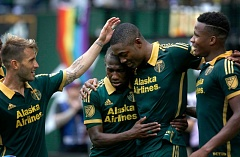 TRIBUNE PHOTO: JONATHAN HOUSE - The Portland Timbers celebrate a goal in their 4-1 shellacking of the Seattle Sounders.