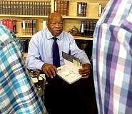TRIBUNE PHOTO: PETER WONG - U.S. Rep. John Lewis was at Powell's City of Books Saturday signing copy of 'March,' Book 2, part of planned three-part graphic novel about the civil rights movement and his role in it.