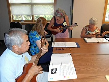 SPOKESMAN PHOTO: PHIL FAVORITE - From left to right, Ty Kuhns, Marla Sweningnson, Laurien Hamilton and Alice Hewitt playing a tune during the weekly ukelele jam in Wilsonville.