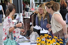 SUBMITTED PHOTO: HOME BUILDERS ASSOCIATION OF METROPOLITAN PORTLAND - Guests check out vendor booths featuring spa, fashion and cosmetic products at last years Street of Dreams in happy Valley.