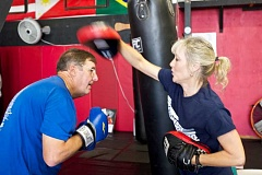 TIMES PHOTO: JAIME VALDEZ - Pat Sousa boxes with Kimberly Berg, coach of Rock Steady Boxing Program, during a class at a local gym in Tigard.