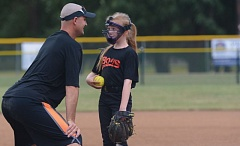 THE OUTLOOK: DAVID BALL - Rainbows coach Bryan Serniotti takes a visit to the pitchers circle with Brylee Haga during the teams 14-3 win over the Eagles in Saturdays second round.