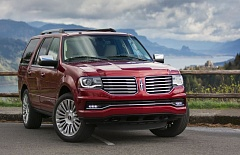 TRIBUNE PHOTO: JOHN M. VINCENT - The 2015 Lincoln Navigator features a new front-end design with HID headlights standard. The optional Reserve package adds 22-inch wheels and automatic running boards that tuck up neatly to the quarter panels.