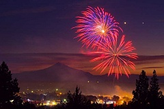 SUBMITTED PHOTO - A picturesque background, with Mount Jefferson, the lights of Madras, and Venus and Jupiter, in the upper right corner, sets off the Madras Sparklers' July 4 fireworks display.