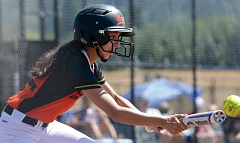 THE OUTLOOK: DAVID BALL - The Rainbows Alejandra Ortega lays down a bunt during Saturdays quarterfinal loss to the Sandy Thunder.