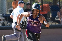 THE OUTLOOK: DAVID BALL - The Voodoo Dollz Monique Lyons races down the first-base line for a single to start the second inning Saturday.