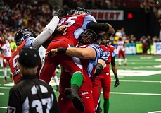 TRIBUNE PHOTO: DIEGO G. DIAZ - Teammates give Portland Thunder receiver Perez Ashford a lift after his first-half, 27-yard touchdown catch in a 72-48 win over the Jacksonville Sharks.