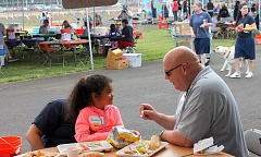 ANDREW KILSTROM - TACE founder John Ludlow interacts with a child at Saturday's event.