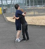 ANDREW KILSTROM - Angela Kim, left, gives her son, Alex, a warm embrace at Saturday's TACE event at Coffee Creek Correctional Facility.
