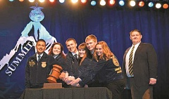 FFA - State FFA President Luis Mendoza, far left, shares the ceremonial gavel with fellow state officers after the election.