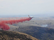 PHOTO COURTESY OF THE U.S. FOREST SERVICE - A very large airtanker drops retardant on the Ten Mile Canyon Fire on July 9.