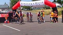 ALS ASSOCIATION OREGON AND SW WASHINGTON CHAPTER - Bicyclists cross the finish line at last year's Ride to Defeat ALS event in Mount Angel.
