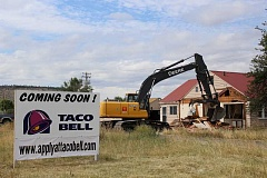 JASON CHANEY - Demolition of a residence occupying the future Taco Bell location began late last week. Restaurant owner Mike Sanders hopes to break ground early this week.