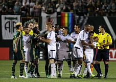 TRIBUNE PHOTO: DAVID BLAIR - Players for Portland and Vancouver have a few things to say after Saturday night's 1-1 draw at Providence Park.