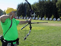 SHERWOOD GAZETTE: RAY PITZ - One of 70 archers from Oregon and Washington takes practice shots July 18 before the opening of the annual Robin Hood Festival Archery Contest.