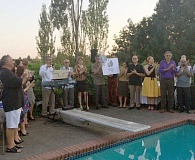 SUBMITTED PHOTOS - The board of directors of Andisheh Center gather on the pool deck for the reveal of a new logo for Andisheh Center.