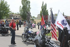 SUSAN MATHENY/MADRAS PIONEER - Some 80 motorcyclists riding with Tribute to the Troops met the Tucker family at the Pfc. Tommy Tucker memorial statue near Madras City Hall last week.