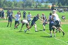 SPOKESMAN PHOTO: COREY BUCHANAN - Harrison Steiger reaches for the end zone against Oregon City during Passing Day.