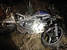 SUBMITTED PHOTO - A motorcyclist was hospitalized after his motorcycle went through a barbwire fence and ended up 75 yards off Lone Pine Road, between Jefferson and Crook counties early Saturday morning, July 18.
