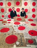 COURTESY: OBON 2015 - Rex and Keiko Ziak of Obon 2015 are surrounded by Japanese flags captured on the battlefields of WWII. These flags and the stories they carry will be part of the Yosegaki Hinomaru exhibit, opening July 25 at the Oregon Nikkei Legacy Center.