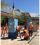 COURTESY PGE - Workers installing an EV charging station at the new location for Electric Avenue near the World Trade Center buildings in downtown Portland.