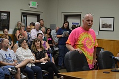 COURTNEY VAUGHN - Jeff Dotter asks the Scappoose City Council to approve an ordinance that will amend the city's code to allow medical marijuana dispensaries. Dotter and others filled the council chambers Monday, July 20, to address the council during a public hearing.