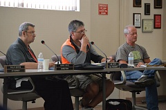 SPOTLIGHT PHOTO: COURTNEY VAUGHN - Columbia River PUD directors Harry Price, Jake Carter and Dave Baker review data during a meeting Tuesday, July 21. The board of directors is expected to vote on an energy rate increase in August.