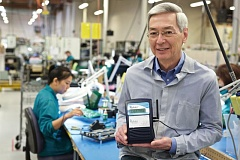 PAMPLIN MEDIA GROUP: JAIME VALDEZ - Don Aultman, CEO and founder of AirAdvice for Homes, holds an AirAdvice IAQ monitor on the shop floor where it is manufactured in Vancouver, Wash.