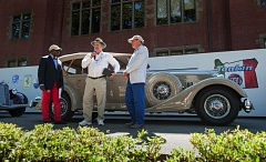 TRIBUNE PHOTO: JOHN M. VINCENT - Larry Nannini (center) of Colma, Cal. receives the Best in Show award from presenters Donald Osborne (left) and Keith Martin. Nannini's 1934 Packard 1104 Super 8 sport phaeton is one of only three of the type believed to still exist.